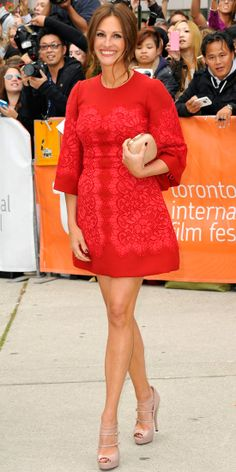 09/10/13: Julia Roberts brought the glam to the 2013 Toronto International Film Festival in a cherry red Dolce & Gabbana dress, Me&Ro gold leaf earrings, and nude accessories. #lookoftheday