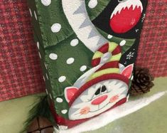 This is a decorative painting pattern packet that includes full color photos, line drawing and directions to paint your own cement brick. Pattern can also be painted on other surfaces such as wood or fabric. Christmas Tree Painting, Christmas Wood, Christmas Crafts, Christmas Decorations, Christmas Ideas, Snowman Decorations, Christmas Plates, Christmas 2014, Christmas Ornaments