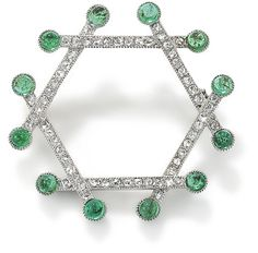 An Art Deco diamond and emerald brooch, by Cartier  Of hexagonal form, and designed as a series of intersecting batons, each baton millegrain-set with rose-cut diamonds and terminating in millegrain-set cabochon emeralds, length 29 mm, signed 'Paris, Cartier, Londres'.