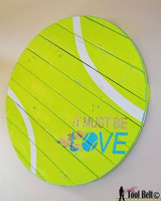 Make a giant tennis ball pallet sign for your tennis fans! Find more tennis ideas, quotes, tips, and lessons at #lorisgolfshoppe