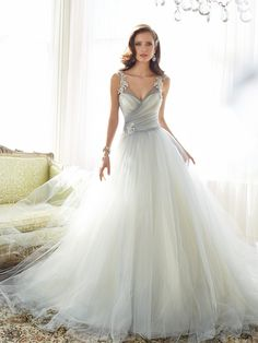 Leave a lasting impression with layers of misty tulle in a regal ball gown silhouette. Nightingale features a double illusion draped tulle V-neckline that delicately conceals a satin sweetheart bodice. Decadent crystal hand-beaded lace motifs adorn the shoulder straps and a matching brooch sits at the waist. A chapel length train and back zipper trimmed [...]