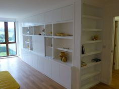 fitted bookcase with hidden television storage http://www.peterhendersonfurniture.co.uk/TV-cabinet-bookcase.html