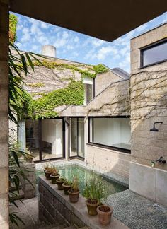 concrete renovation in Ghent, Belgium, of that 1972 house by DEPOORTER-HOLDRINET INTERIOR ARCHITECTS