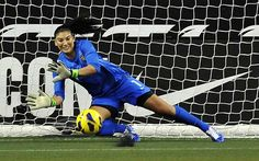 Hope Solo makes a save vs. China, Dec. 8, 2012. (John T. Greilick/The Detroit News)