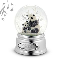"♫ Plays ""Born Free"" Pandas are known for developing a special bond with their baby, and that connection between mother and child really comes to life in this charming snow globe.  And with your engraved message (Congratulating a new mom? Celebrating baby's birth?), this is a gift that will resonate with her for years to come. Both mom and baby panda shine with beaded silver detailing while the globe                  ..."