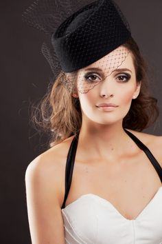 pillbox hat with veiling.