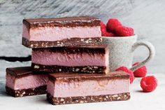 This raw raspberry slice tastes just as good as it looks, making it the perfect mid-afternoon treat that you don't have to feel guilty about. You can access this raw raspberry slice along with other guilt-free recipes in delicious. Raw Food Recipes, Dessert Recipes, Free Recipes, Healthy Recipes, Popular Recipes, Drink Recipes, Delicious Recipes, Fererro Rocher, Kolaci I Torte