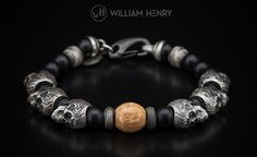 Bead bracelet with black onyx, sterling silver skulls and fossil walrus ivory. And a nod to #GameOfThrones