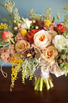 coral and peachy pink roses, stock, helleborus, dusty miller, (other fir-like greenery), (yellow clusters) for summer and early fall