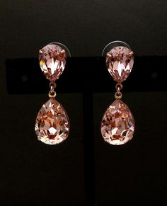 Swarovski vintage rose blush pink crystal teardrop pendant with foiled coating on the back. Rose Gold plated brass earring. post is sterling silver. Swarovskis precision cut facets bring out truly dramatic colors to these earrings. Size: 3.6cm x 1.4cm  matching necklace