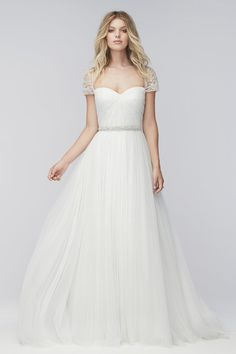 2a5aec7309d2 This wedding dress has a little bit of everything  lace