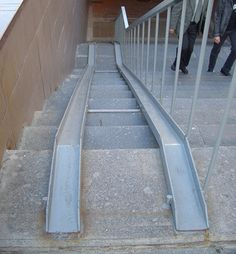 Portable aluminum ramp for easy wheelchair access up some stairs