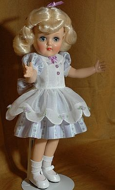 The Ideal Toni doll was introduced in 1949 as an advertising doll for Toni Home Permanent.   Toni is made of all hard plastic, has a jointed body, the earliest dolls wore a nylon wig, she has sleep eyes usually in blue but other colors too, real upper eyelashes, painted lower lashes, a small rosebud painted closed mouth and was a loved doll by many little girls and today by doll collectors of all ages.