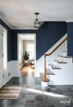 - Stairway Designs & Ideas - A look at my newly painted entryway. Color: Farrow and Ball Stiffkey Blue A look at my newly painted entryway. Color: Farrow and Ball Stiffkey Blue Hallway Colours, Room Colors, Blue Hallway Paint, Dark Blue Hallway, Entryway Paint Colors, Stiffkey Blue, Navy Walls, White Walls, Flur Design