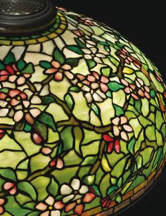 "Lot | Sotheby's HE GEYER FAMILY COLLECTION TIFFANY STUDIOS ""APPLE BLOSSOM"" FLOOR LAMP shade impressed TIFFANY STUDIOS NEW YORK 1512-12 base impressd TIFFANY STUDIOS/NEW YORK/387 leaded glass and patinated bronze 65  1/4  in. (165.7 cm) high 22  1/2  in. (57.2 cm) diameter of shade circa 1910 Estimate 60,000 — 80,000 USD  LOT SOLD. 93,750 USD"