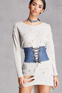 A corset crafted from denim featuring adjustable faux leather lace-up closure.