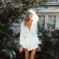 The Lovestruck Romper radiates a casual, cool style perfect for a beach-chic fashionista! Features a plunging V-neckline with a button clasp, long bell sleeves, and floral lace trim along the neckline