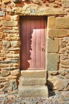 Notice how the soft pink and gray door pick up the colors in the stonework, beautiful