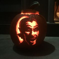 Vampire pumpkin. Used a pumpkin carving kit from Walgreens. Basically get the picture you want, wet it, and stick it on your pumpkin. Wrap the picture with Saran Wrap. I poked holes on the outline of the picture, and then carved away!