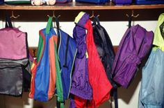 How to Organize a Front Entrance Closet: Hooks make easy work of organizing backpacks and bags.