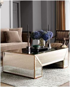 Stylish home: Mirrored furniture | The best coffee tables home design ideas! See more inspiring images on our boards at: http://www.pinterest.com/homedsgnideas/home-design-ideas-coffee-tables/