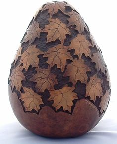 I've seen this gourd many times, but it hasn't gotten tiring. The rustic, deep carving, and dark stain is quite something. by Mary Hogue