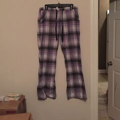 Lounge pants Cute purple and black plaid lounge pants. Will roll up and button on legs to make capris. Lounge by Maurices Intimates & Sleepwear