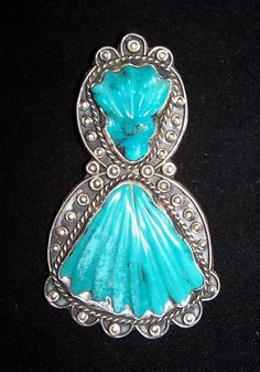silver pendant, carved turquoise leaves, Randolph Sahmie, pueblo smith