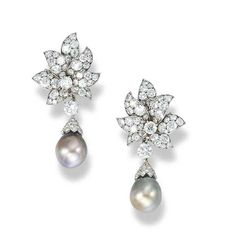 A pair of natural pearl and diamond ear pendants, by Van Cleef & Arpels.