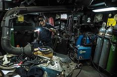 Hull Maintenance Technician Fireman Leahmond Tyre, from Philadelphia, uses a blowtorch to shape a specialty part aboard the U.S. Navy's only forward-deployed aircraft carrier USS Ronald Reagan (CVN 76).