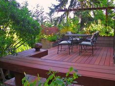 Wrap a deck corner with planters. Box planters add architecture and foliage to a deck. When they are placed right, they can provide extra privacy and shade. Depending on what you plant, they can also add colorful flowers and lovely fragrances