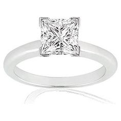 The diamond solitaire ring is a timeless classic and the quintessential reflection of everlasting love. This beautiful engagement ring features a fiery carat princess cut diamond four-prong set in polished white gold. Engagement Rings Princess, Princess Cut Rings, Beautiful Engagement Rings, Princess Cut Diamonds, Vintage Engagement Rings, Beautiful Rings, Platinum Wedding Rings, Wedding Rings Solitaire, Diamond Solitaire Rings