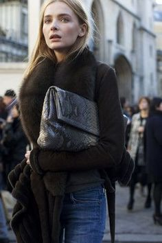 That leather clutch is awesome.  Brown coat with fur collar. Latest arrivals.
