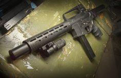 SEG AR-15 9mm full auto with SEG Titanium Hancock Black Suppressor. Available at https://www.segsuppressors.com/suppressors.html