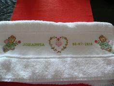 Geborduurde rand (kruissteek) op handdoek.