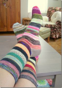 To make these, I cast 60 stitches on my favorite US 1 dpns and work 10 rounds of k2, p2 ribbing. Then switch to another color and work 10 r...