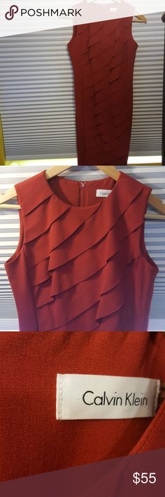 Like New Calvin Klein red ruffled dress Looks brand new and is such a sultry fit. Ruffles elegantly cascade down the entire front and zipper runs along half the back and is pleated as well. Size 2 petite. No defects.🌻 Calvin Klein Dresses