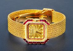 Cartier 18k Gold, Diamond, and Ruby Watch (sold for $9,000 at a 2012 Fortuna Auction).