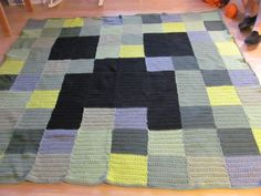 I crocheted a Mindcraft afghan for my grandson.  It is really large and will fit a double bed.  There are 100 blocks.  Each block is 20  stitches by 12 rows.