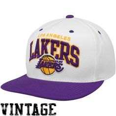 Mitchell & Ness Los Angeles Lakers Purple-White Arch Two-Tone Snapback Adjustable Hat Stand ready to reel in another win for the Lakers when you sport this Arch Two-Tone Snapback hat from Mitchell & Ness! Featuring the team name arched over an embroidered throwback logo on the crown and a stylish flat bill, this adjustable hat is sure to ignite the cheers of fans young and old!85% Wool/15% AcrylicFlat billAdjustable ...