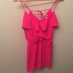 American Eagle hot pink romper Worn once. Brand is crossed out. Drawstring does not tighten the romper. Can clasp at chest. American Eagle Outfitters Dresses Mini