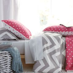 Nothing but sweet dreams in a bed layered with bold prints and bright colors.