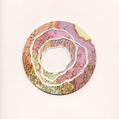 """Artist Shannon Rankin does amazing things with maps. Treating them as mere pieces of decorated paper to be manipulated—clipping out spirals, folding crevassed roses of ridges and faultlines, pinning up confetti-like clouds of circles and zigzags—she creates """"new geographies, suggesting the potential for a broader landscape."""""""