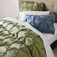 i like this bed spread. i seem to like bed spread w/ texture... and i love green so this works.