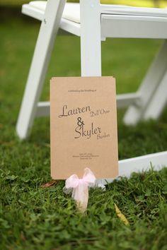 Kraft paper wedding programs - rustic wedding program idea - kraft paper fans + pink ribbon {Jasmine Rose Photography}