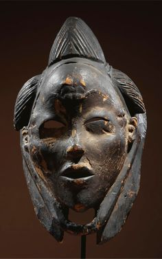 Africa | ikwar''or ikwara' mask from the 'Punu-Lumbo people of Gabon | Wood, black pigment and kaolin | ca. 19th to beginning of the 20th century