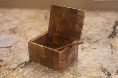 This salt box is an excellent combination of beauty and functionality. It looks stunning in your kitchen, youll love the detail of the teak wood grain. This box keeps salt, spices, and herbs within reach while in the kitchen. The size of the box is 10cm x 8cm x 6cm (width x length x height.) The box is made from several small pieces of teak wood which are glued together. Each spoon is carved by hand. Please note, these items are hand made and there will slight be variances to the final look…