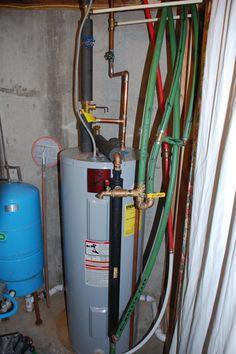 Heat exchanger at water heater. Outdoor Wood Furnace, Heat Exchanger, Home Appliances, Water, House Appliances, Gripe Water, Appliances