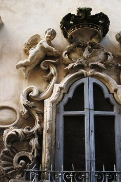 Baroque window detail Scicli, Sicily. Scicli is a gem of a Unesco World Heritage town, and while lesser known than its neighours of Modica, Noto and Ragusa, is just perfect for discovering. It's more 'true Sicily' and less touristy.