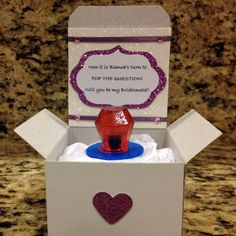 Give each bridesmaid a ring pop in your wedding colors.